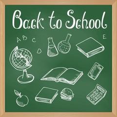 Green blackboard with chalk-drawn school objects
