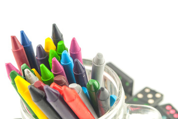 A stack of colorful crayons on an isolated white background