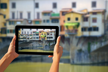 Ponte Vecchio Woman taking pictures on a tablet