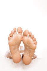 nice pedicure female feet on white background