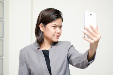 Business woman taking photo herself selfie
