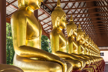 golden buddha statues sitting in row on thai temple