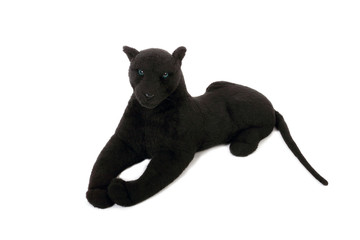 Cute black panther soft toy with long tail lies isolated