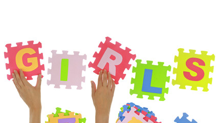 "Hands forming word ""Girls"" with jigsaw puzzle pieces isolated"