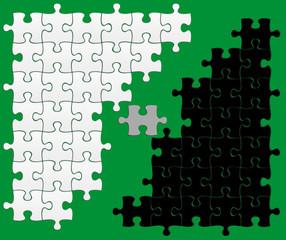 puzzle noir / blanc sur fond vert