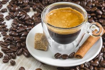 fresh espresso coffee in transparent glass with golden crema