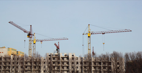 Inside place for many tall buildings under construction and cran