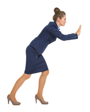 Portrait of business woman pushing something in front