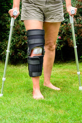 Woman with knee in brace after injury