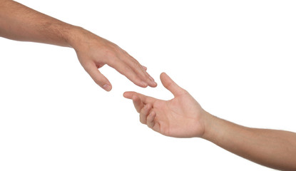 Two male hands reaching towards each other. Isolated