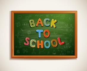 Back to school written on blackboard