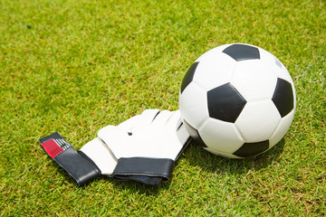 Soccer ball and goal keeper gloves set for shooting