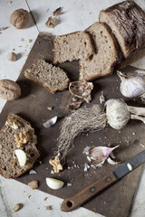 homemade wholemeal sliced bread with walnuts and garlic