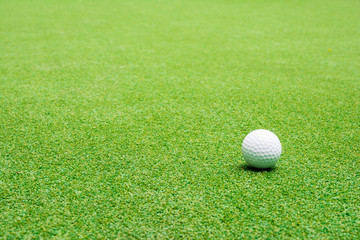 Golf ball on the green grass.