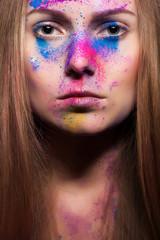 Fashion make up from powder on beautiful woman face