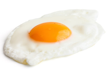 Single fried egg on white.