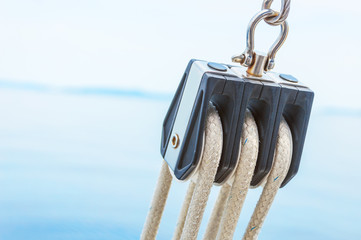 Closeup of pulley on sailing