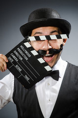 Funny man with movie clapper board