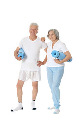 Couple with fitness mats
