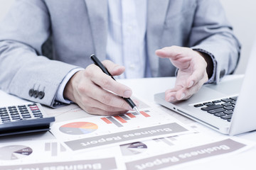 Businessman analyzing investment charts with laptop. Accounting