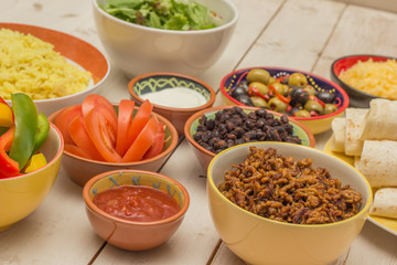 Variety of ingredients to make mexican burritos