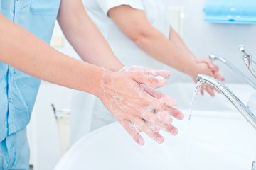 Surgeon washing hands before operation