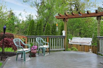 Wooden deck with garden swing