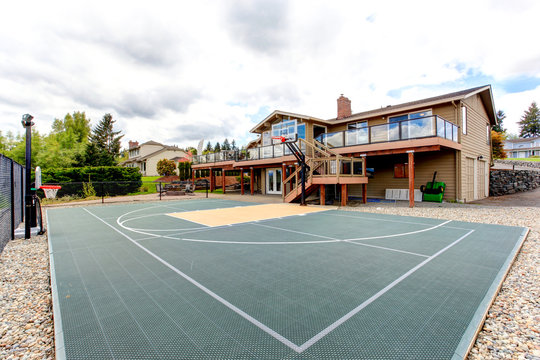 House backyard with sport court and patio area