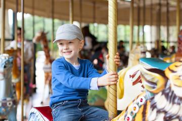 boy at carousel