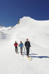 Zauchensee, drei Personen Langlauf in Bergen