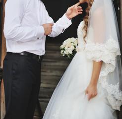 Young newlyweds spending happy wedding day.