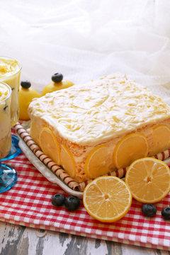 Tasty lemon cake on table, closeup
