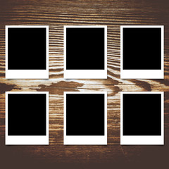 Polaroid photo frame on wood background