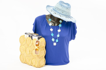 Blue blouse on mannequin with matching accessories