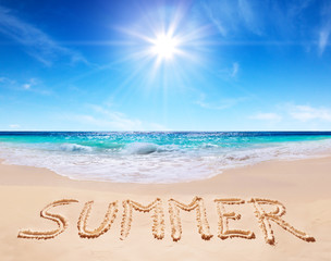 "word ""summer"" written on the tropical beach"