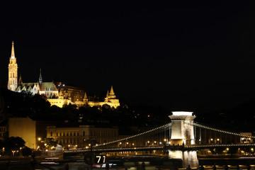 illuminated Fisherman bastion and chain bridge Budapest by night