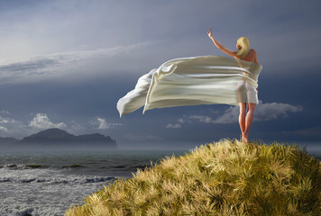woman with a white tissue on a mountain top