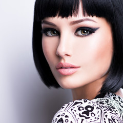 Beautiful young brunette woman with short hairstyle.
