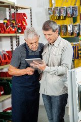 Salesman With Customer Using Digital Tablet