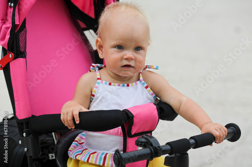 346740bf33f Cute baby girl riding her first bicycle