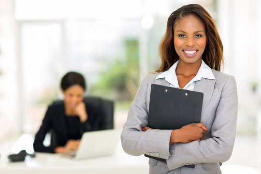 black business woman holding clipboard