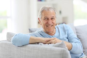 Portrait of smiling senior man with blue shirt