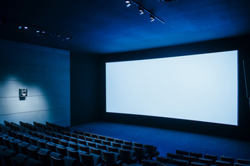 Wall Murals Theater Cinema dark movie theater with blank screen