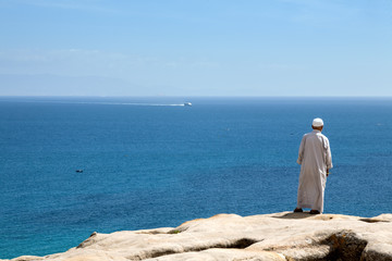 Muslim man back at the seaside
