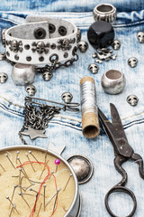 composition with sewing accessories and skull jewelry