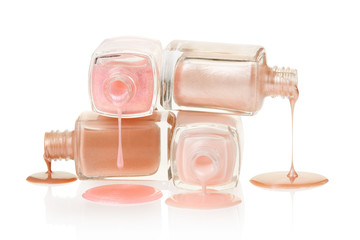 Pink nail polish spilled on white, clipping path