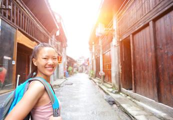 woman tourist at xingping ancient town in guilin ,china