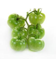 green tomatoson on white background.