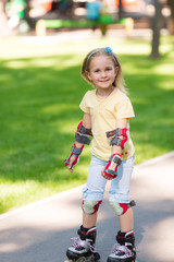 Little girl rollerskating in the park