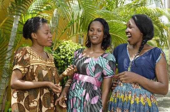 Three Happy African women Chatting Outdoor